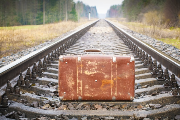 Old suitcase on the railway